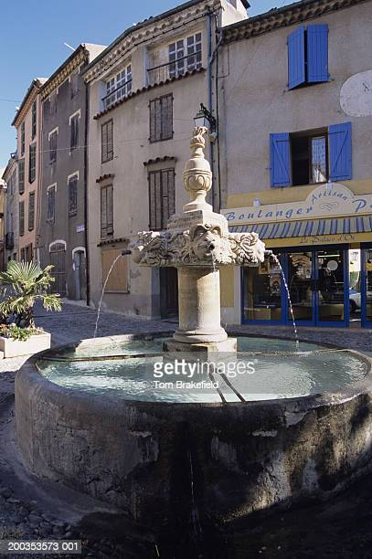 Fountain on street in old hilltop village, Provence, France