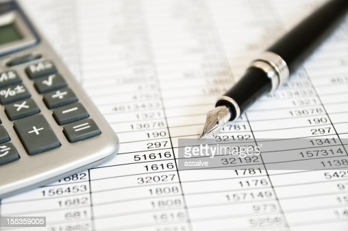 fountain pen, calculator and figures