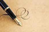 Fountain pen with flourish on vintage paper