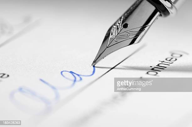 Fountain pen signing signature on paperwork