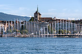 Fountain show at the Geneva Lake Festival in august. View from the lake on the Saint Piere Cathedral.