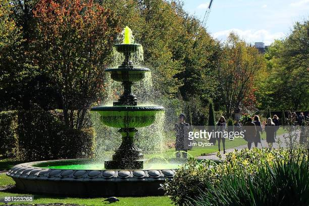 A fountain with bright green water during the Frieze Art Fair in Regents Park on October 6 2017 in London