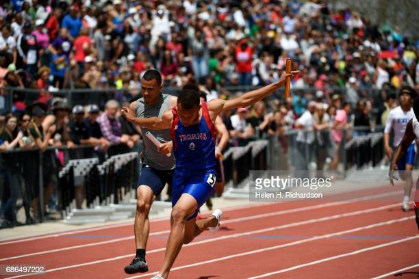 FountainFort Carson's Donovan Williams crosses the finish line to win the boys 5A 4x100 meter relay during the final day of state track and field...