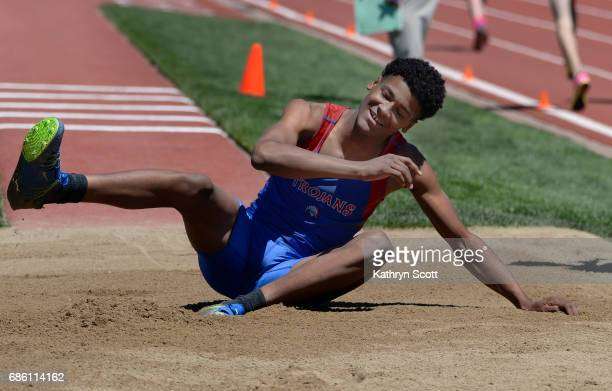 FountainFt Carson's Jequan Hogan is all smiles after making the eventwinning jump in the boys 5A triple jump The state track and field championships...