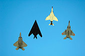 An F-22 Raptor, an F-117 Nighthawk, an F-4 Phantom and an F-15 Eagle fly over Holloman Air Force Base, New Mexico, October 27, 2007 during the Holloman Air and Space Expo.  The expo showcased Air Forc