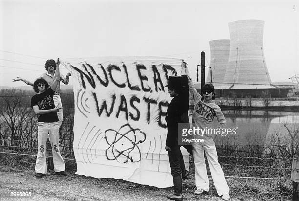 Four antinuclear power protestors stand holding a banner reading 'nuclear waste' on Three Mile Island near Harrisburg Pennsylvania USA 1979 1979 saw...