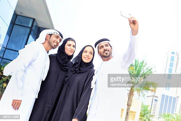 Four arab business people taking a selfie