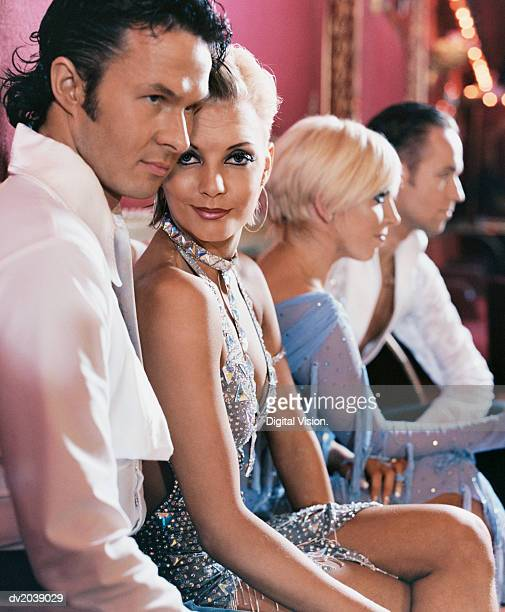 Four Ballroom Dancers Sitting