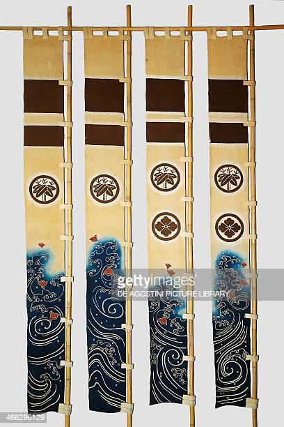 Four banners with motifs depicting plovers in the waves family crests bamboo flower in circles cotton dyed in reserve with rice starch and indigo dip...