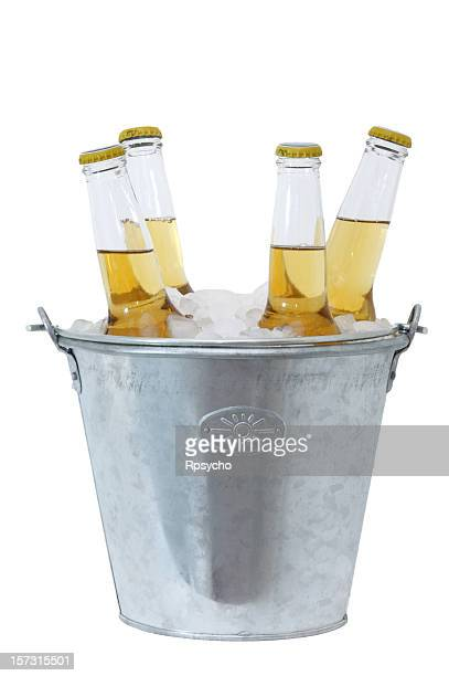 Four beer bottles full and in a stainless bucket of ice