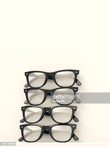 Four black glasses stacked on white background