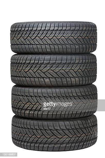 Four black tires stacked on top of one another