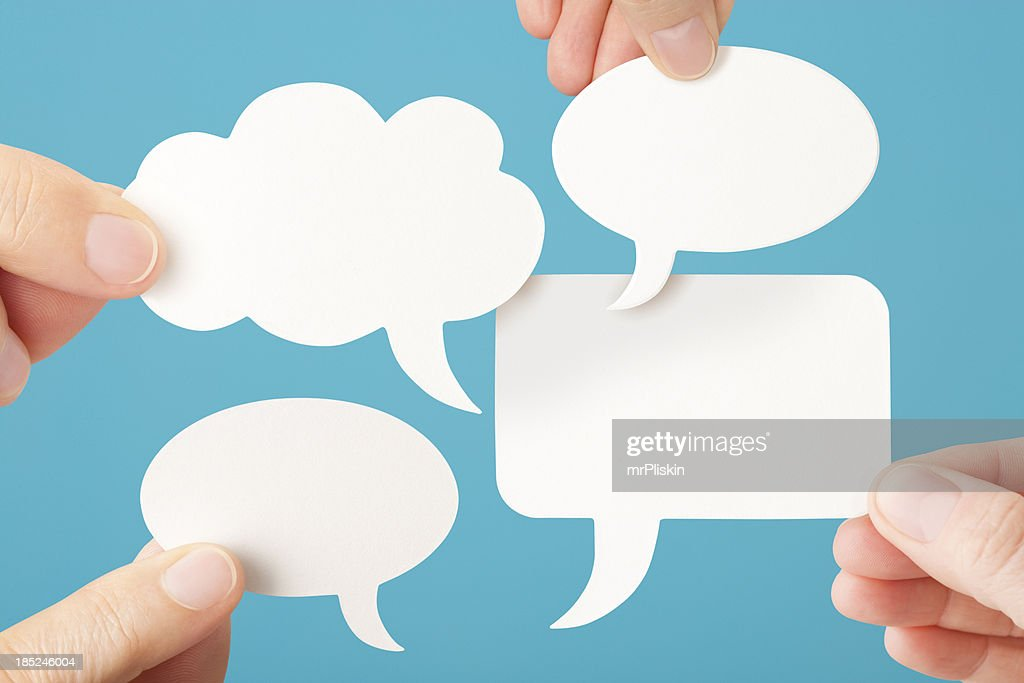 Four blank white conversation speech bubbles