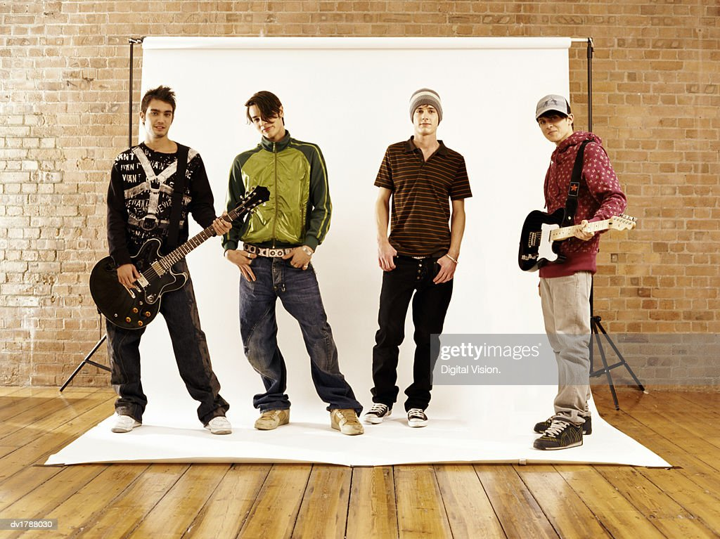 Four Boys in a Music Band Striking a Pose : Stock Photo