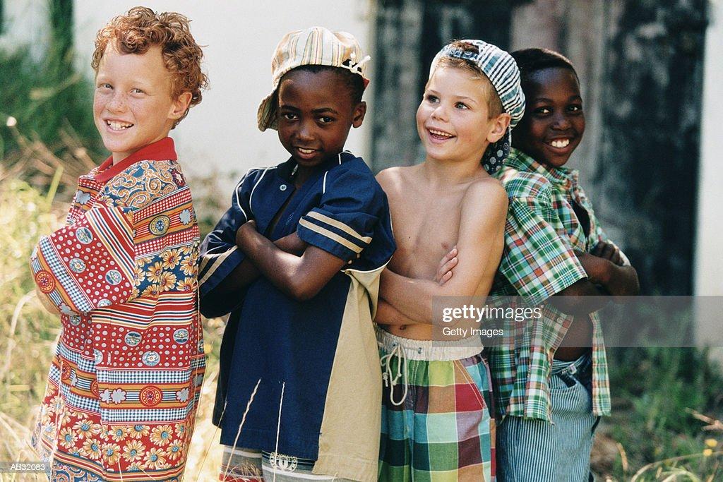 Four boys (5-7) outside, portrait : Stock Photo