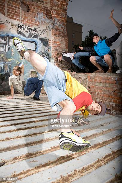 Four breakdancers dancing on the roof of a building, Moscow, Russia