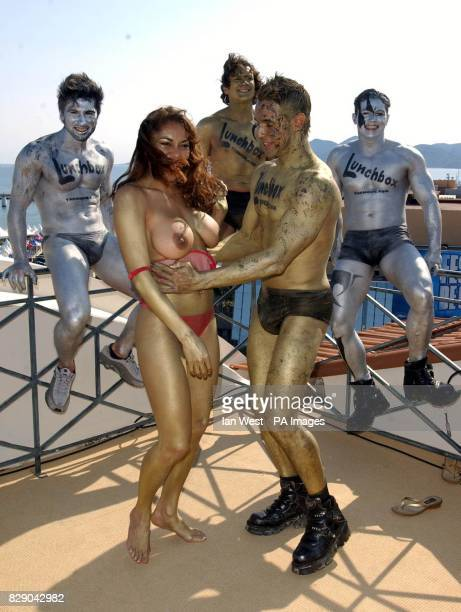 Four British Chippendales one of which is X Factor's Chico pose with a glamour model to help launch the film Lunchbox at the Majestic Hotel as part...