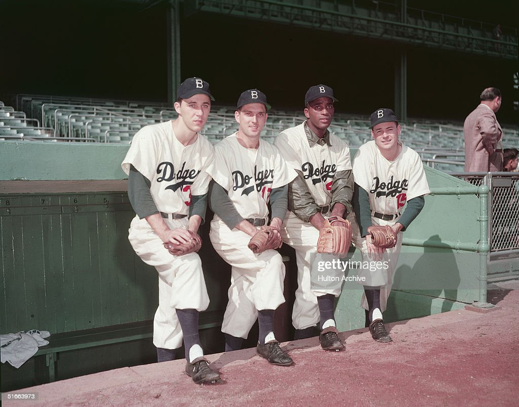 Four Brooklyn Dodger pitchers pose in the dugout, 1952. From left, American baseball players Billy Loes, Carl Erskine, and Joe Black (1924 - 2002), and Canadian John Rutherford.
