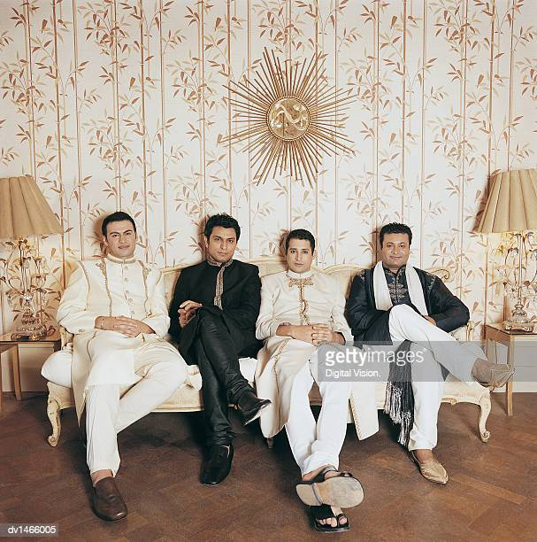 Four Brothers Sitting on an Ornate Sofa in Their Living Room