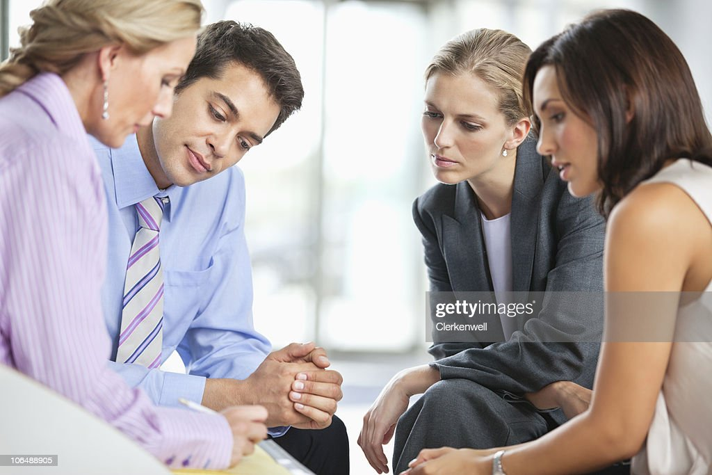 Four business executives in a meeting at office : Stock Photo