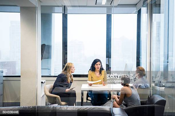 Four business women having meeting in modern office
