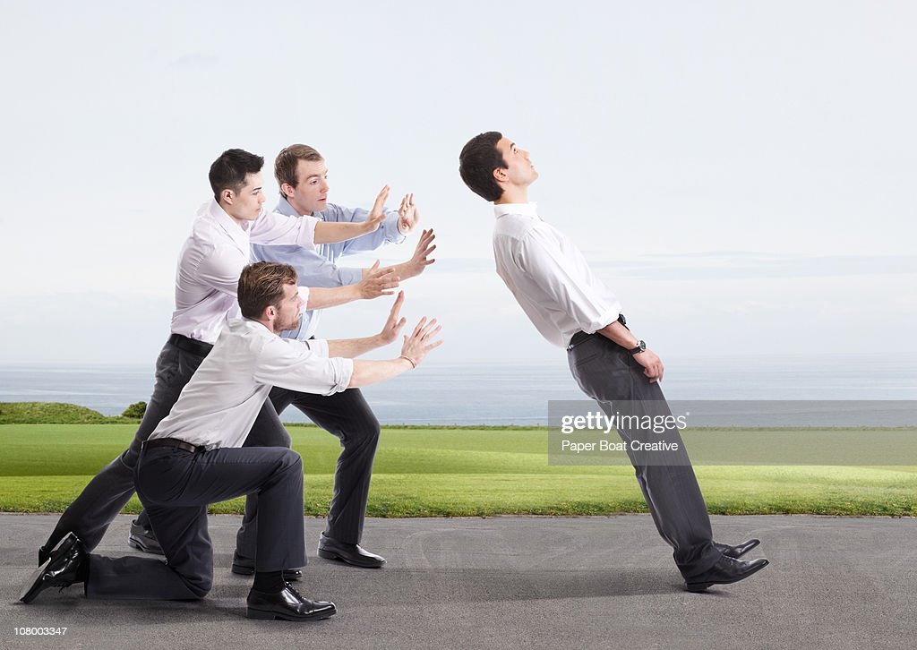 four businessmen playing the game of trust : Stock Photo