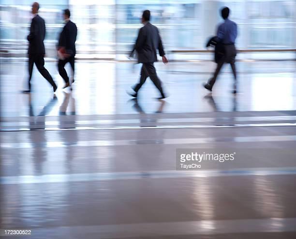 Four businessmen walking