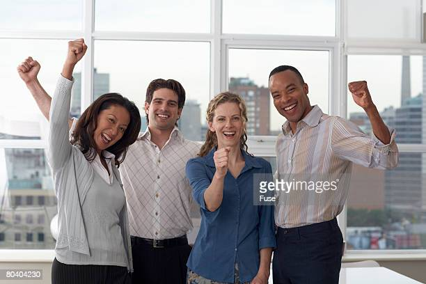 Four Businesspeople Cheering in Office