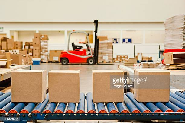 Four cardboard boxes on conveyor belt