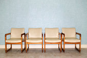 Four chairs in a waiting room