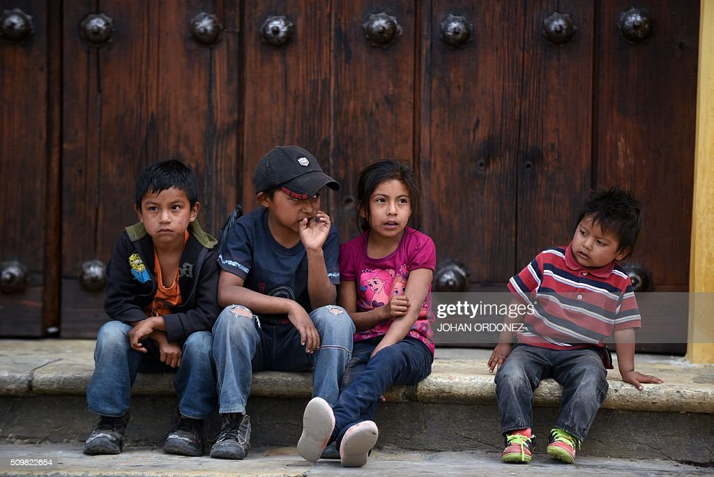 Four children are seen outside of the cathedral of San Cristobal de las Casas, Chiapas State, Mexico on February 12, 2016. Pope Francis will arrive in Mexico on Friday, where he will visit until February 17. AFP PHOTO/Johan ORDONEZ / AFP / JOHAN ORDONEZ