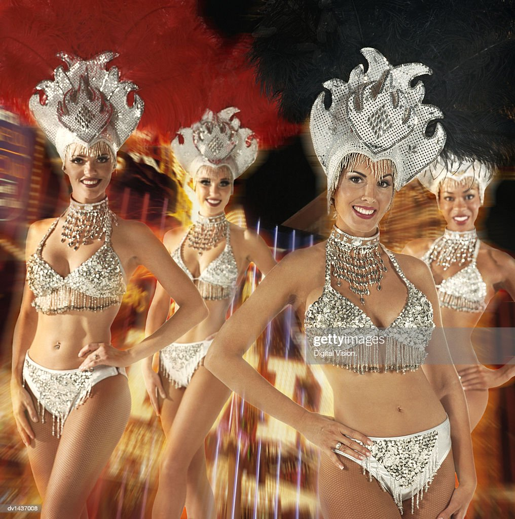 Four Chorus Girls, Against a Blurred Composite Background of Neon Lights : Stock Photo