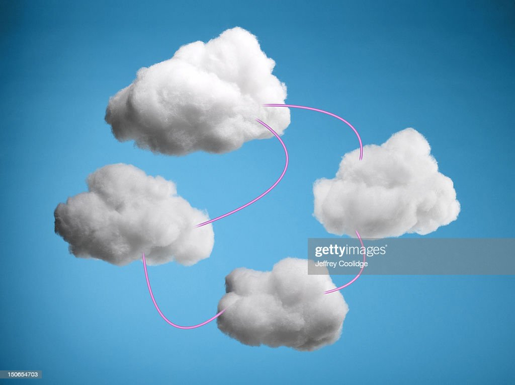 Four Clouds Connected by Pink Wires : Stock Photo