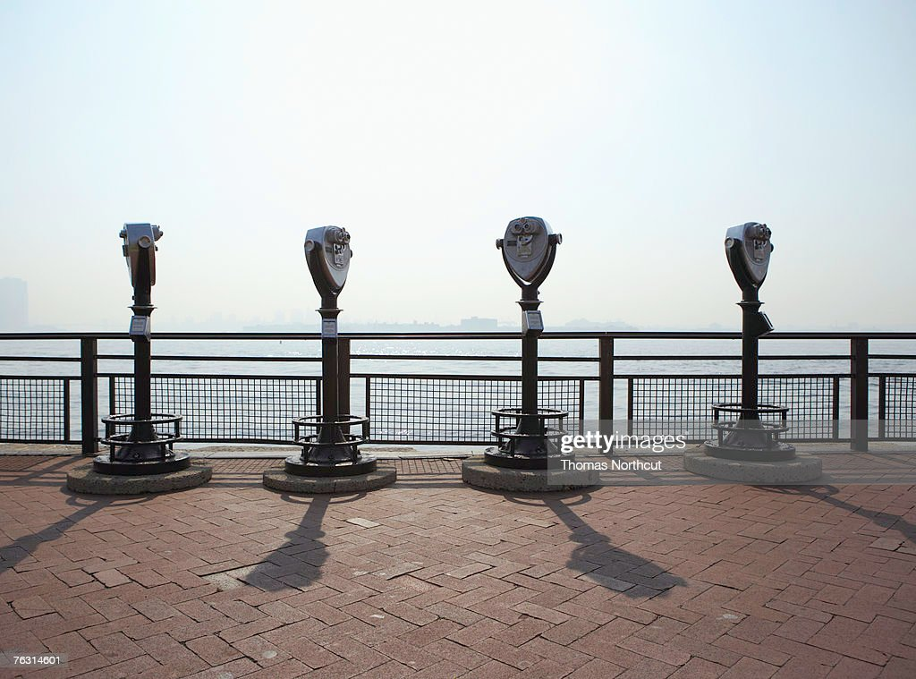 Four coin operated binoculars on promenade
