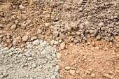 Natural silty soil background: brown, gray and red.