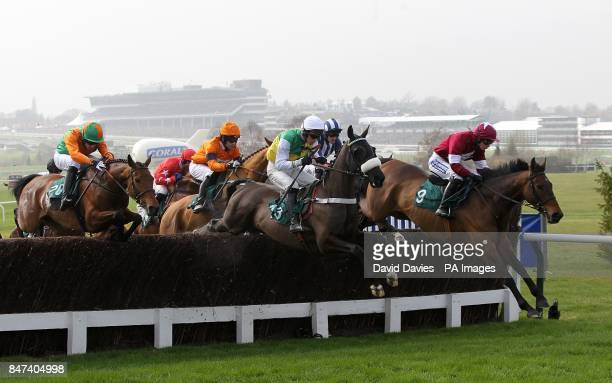 Four Commanders ridden by Nina Carberry leads the Diamond Jubilee National Hunt Chase on Ladies Day during the Cheltenham Festival