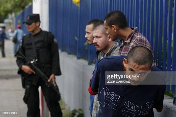 Four convicted members of the Mara Salvatrucha gang remain under custody outside the Isidro Menendez Justice Court after they were recaptured by the...