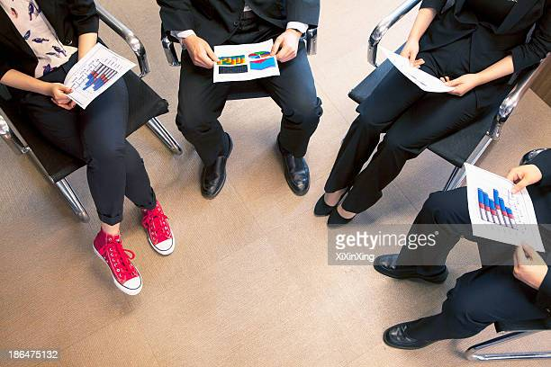 Four coworkers holding a business meeting, high angle view