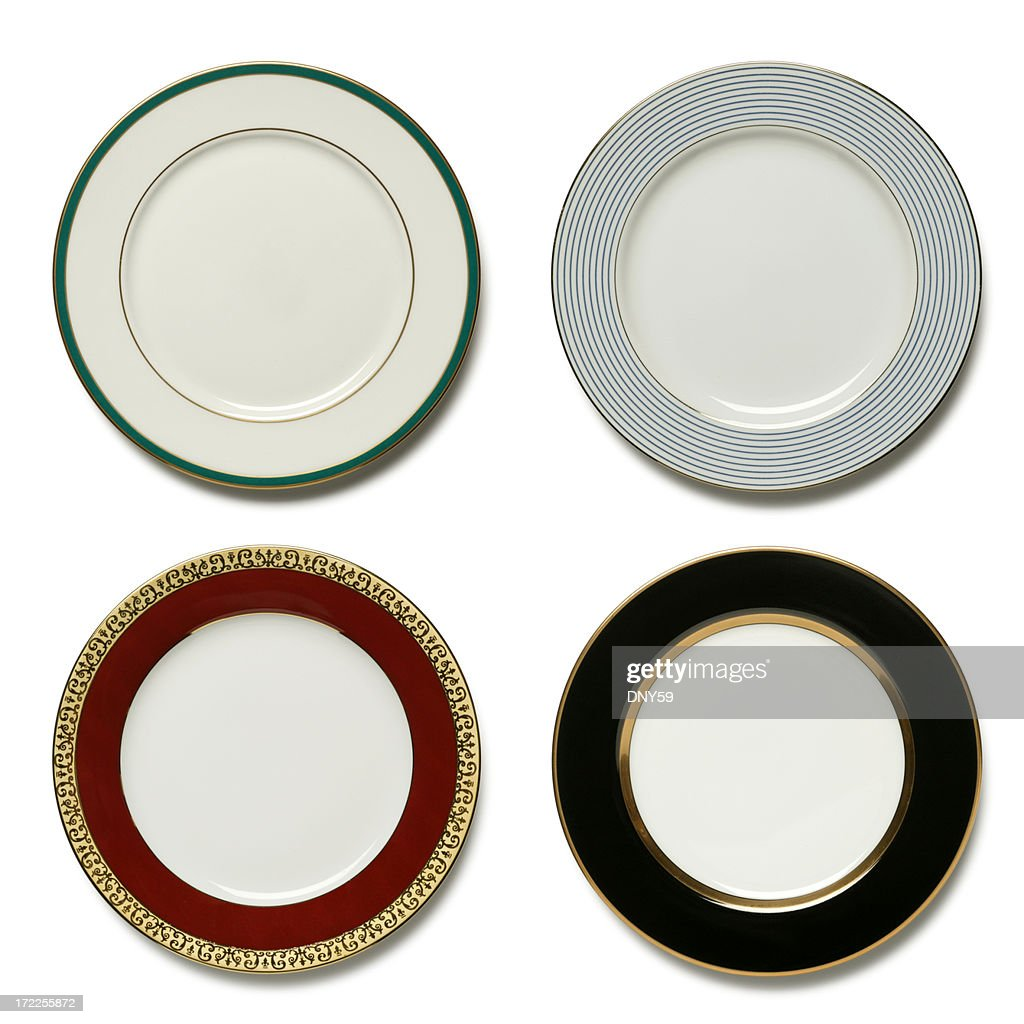 four dinner plates on white background stock photo getty