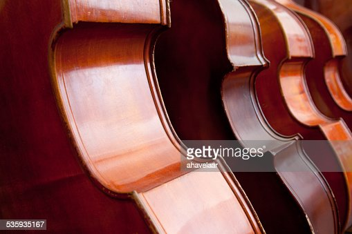 four double basses in a row : Stock Photo