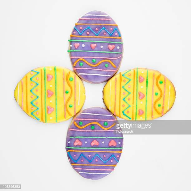Four Easter egg sugar cookies with decorative icing.