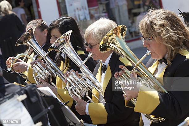 Four female band members playing baritone horns