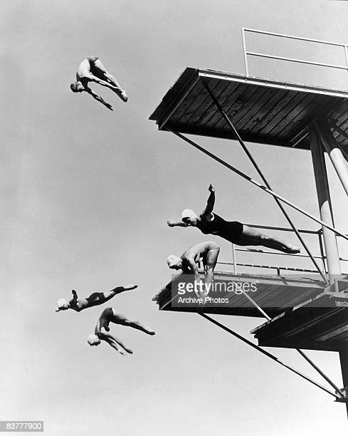 Four female divers and one male practice their form at the high dive at the Arizona Olympic Club near Phoenix Arizona circa 1950