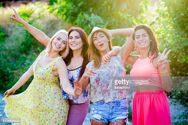 Four female friends having fun outside on summer day