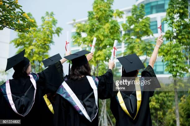 Four female graduates at campus
