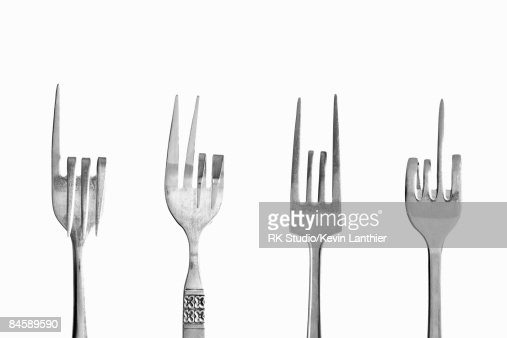 Four forks depicting various hand gestures.