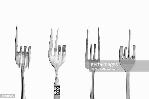 Four forks depicting various hand gestures.