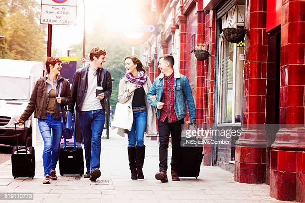 Four friends arriving in London