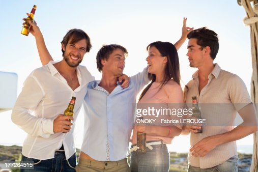 Four friends drinking beer : Stock Photo
