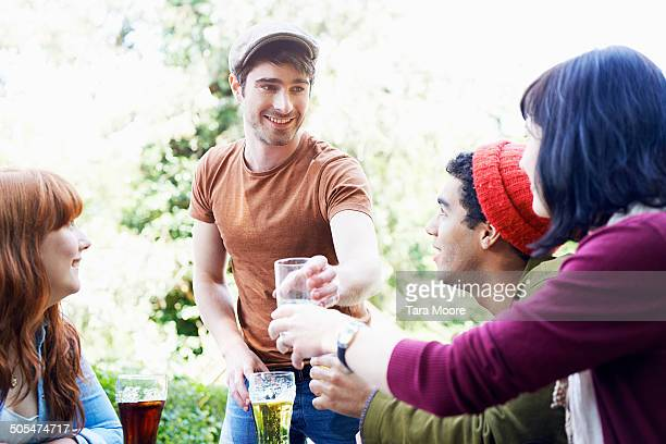 four friends drinking in beer garden